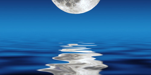 full moon over water at night